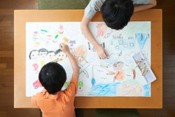 Japanese elementary school students painting in the living room
