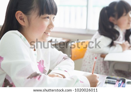 Japanese elementary school students study inside classroom #1020026011
