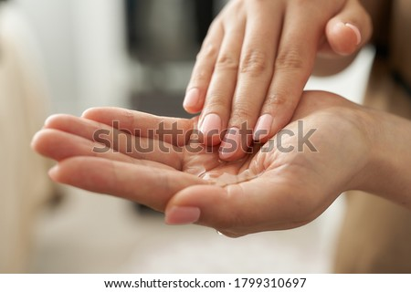 Japanese esthetician holding a massage oil in her hand ストックフォト ©