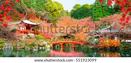Japanese fall autumn.Kyoto Daigo temple with red leaves and pond.  Stock photo ©