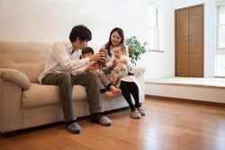 Japanese families relax in the living room
