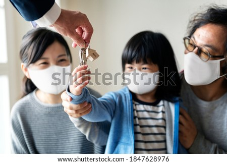 Japanese family in face mask buying a new house