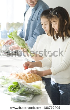 Japanese Father And Two Daughters Cooking In Kitchen Stock Photo 188797205 : Shutterstock