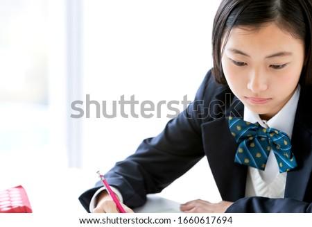 Japanese female students studying seriously Stock photo ©
