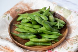 Japanese food edamame nibbles, boiled green soy beans