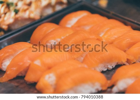 Japanese food in set different types of sushi with seaweed salad and gari (ginger) is a healthy food at the upper right of the serving board in japanese restaurant #794010388