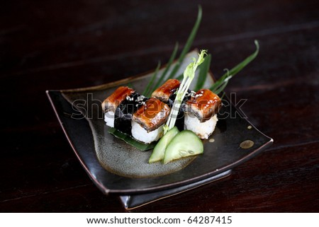 japanese food rice with eel ( unagi ) eel sushi with dark brown wood pattern