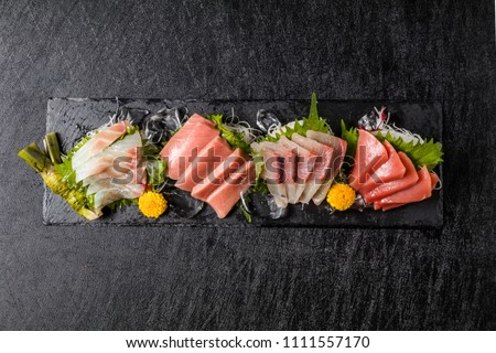 japanese foods sashimi (raw sliced fish, shellfish or crustaceans)