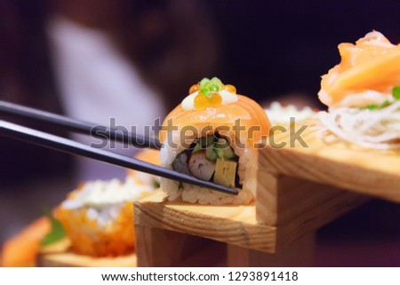 Japanese Fresh Fish Food Dish Menu,  Salmon Sushi and Sashimi Assortment decorating on wooden steps in traditional Japanese Restaurant. Healthy Food rich with fish nutrition and Delicious meal concept
