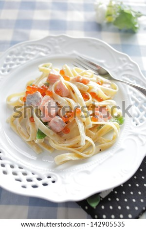 Japanese fusion food, salmon roe Ikura and salmon pasta