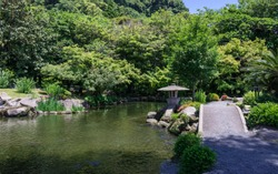 Japanese Garden covered by green Landscape. Taken in the wonderful Sengan-en Garden. Located in Kagoshima, Kyushu, South of Japan.