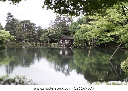 japanese garden with lake reflection
