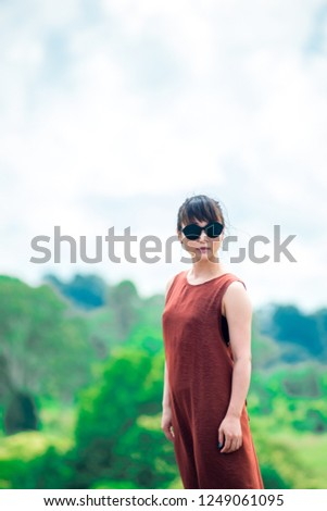 Japanese girl poses for picture in Gold Coast, Australia. Gold Coast is one of the Australia's tourist destination points.