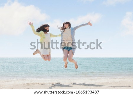 Japanese girls play on the beach