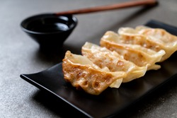 Japanese gyoza or dumplings snack with soy sauce