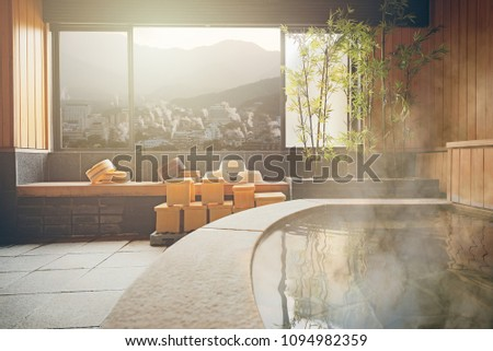 japanese hot spring onsen room with the window view of beppu, oita, Japan