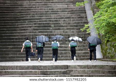 Japanese junior high school students holding an umbrella #1157982205