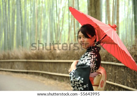 japanese kimono felame with red traditional umbrella