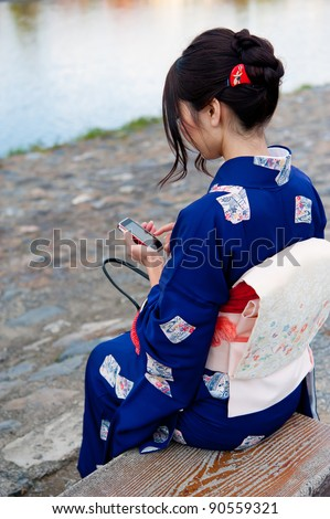japanese kimono woman using a smart phone