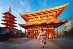 Japanese lady in Kimono dress walking in Sensoji Temple, Asakusa city, Tokyo, Japan. This image can use for travel in Tokyo and Japan concept