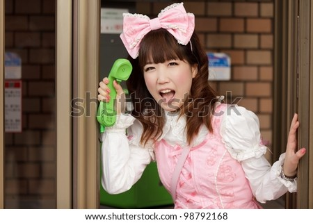 japanese lolita cosplay shouting in public phone