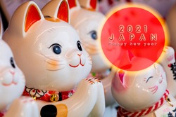 Japanese lucky cat made a greeting card Happy New YearJapanese: Lucky CatChinese: Peace, lucky blessing, good luck, good fortune, ten thousand two gold, royal cat