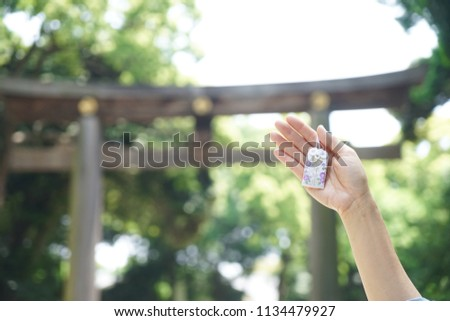Japanese lucky charm. A hand holding omamori or A Japanese lucky charm to wish good luck in love relationship. ストックフォト ©