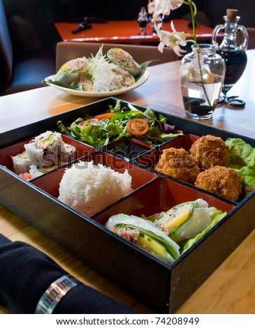 Japanese lunch bento box with fried scallops