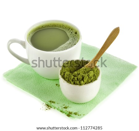 Japanese Matcha green tea in cup and tea powder isolated on white