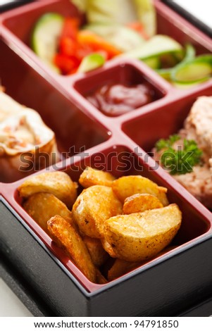 Japanese Meal in a Box (Bento) - Steamed Cutlet, Potatoes and Sweet Fruit Sushi