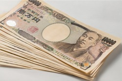 Japanese money. A wad of 10,000 yen.White background.zoom in.