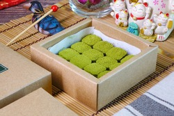 Japanese Nama chocolate Mutcha green tea is a type of ganache, made from a mix of melted cacao, Mutcha green tea powder and fresh cream and sprinkled with Mutcha green tea powder on top.