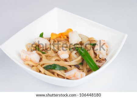 Japanese noodles with seafood - stock photo