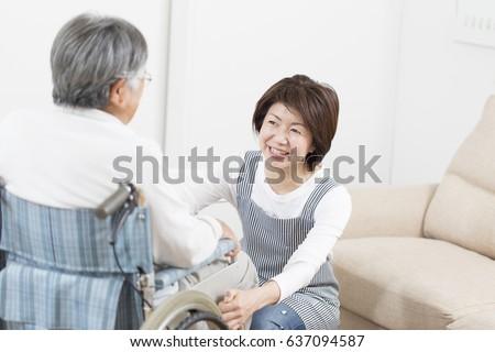 Japanese nursing at home, a Japanese woman nursing at home ストックフォト ©