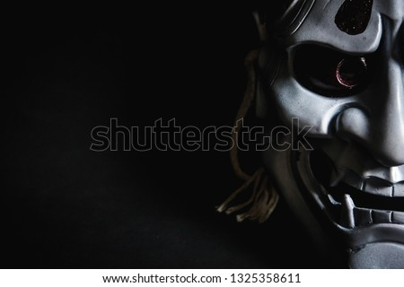 Japanese oni mask or giant mask, used to decorate handmade from original to make it look dark and art, with half of the face then look more scary ストックフォト ©