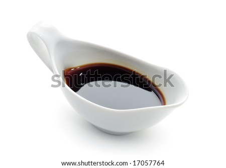 Japanese or Chinese Soy Sauce in Suace-boat. Isolated over White