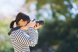 Japanese photographer woman shooting picture