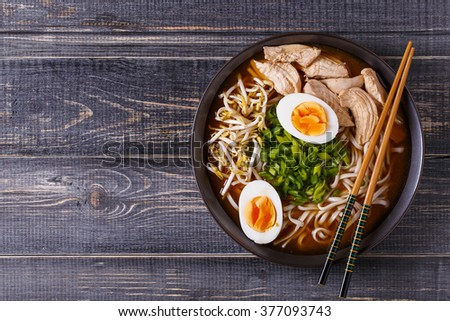 Japanese ramen soup with chicken, egg, chives and sprout on dark wooden background. ストックフォト ©