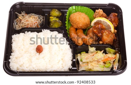 ... , Bento with Hinomaru style rice and deep fried chicken - stock photo