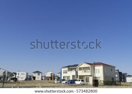 Japanese residential residential area image blue sky looking up at sun #573482800