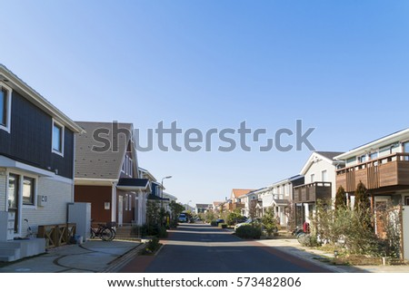 Japanese residential residential area image blue sky looking up at sun #573482806