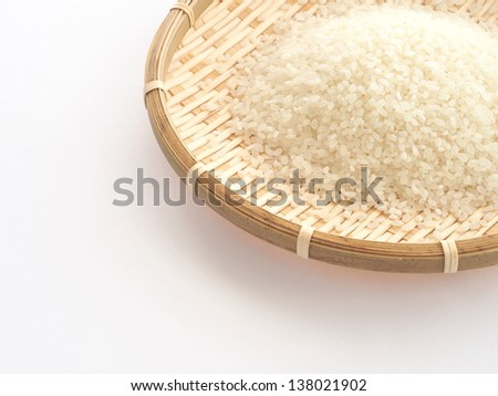 Japanese rice grains on bamboo basket