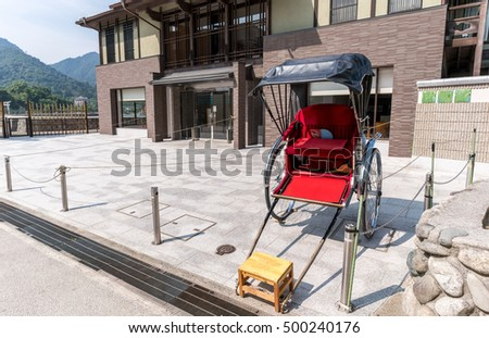 Japanese rickshaw for tourists on Miyajima Island , Hiroshima , Japan