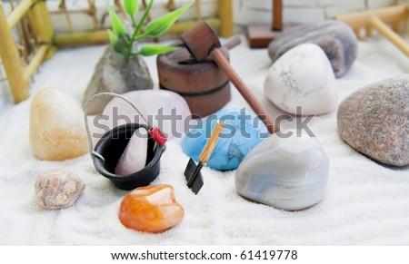 Japanese rock-garden in a miniature macro background, selective focus.