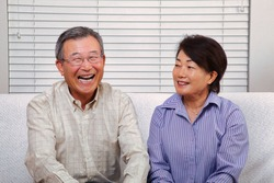 Japanese senior couple smiling at the camera