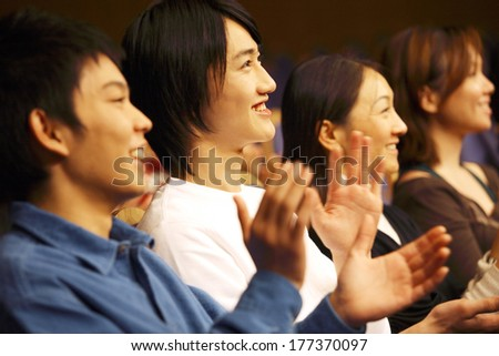 Japanese students clap in a Hall auditorium #177370097