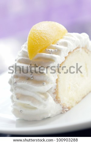 Japanese style fresh cream cake topped with peach fruit.