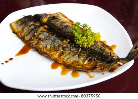 Japanese Style Grilled Fish In A White Plate With Black Sauce Stock ...