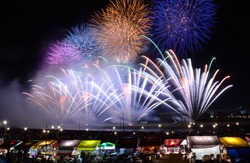 Japanese summer firework festival is bustling with people and stands selling food or drinks