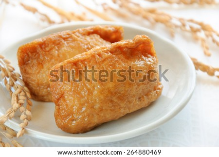Japanese sushi called Inari-sushi, fried bean-curd stuffed with boiled rice